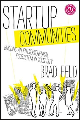 The cover for Startup Communities has roughly sketched outlines of people in a small group at the bottom. They are standing in front of a sketched city skyline.
