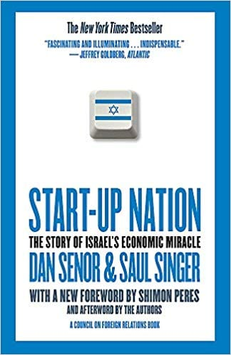 The cover of Start-Up Nation is mostly white with a single computer keyboard key in the center, but the key is printed with the Israel flag.