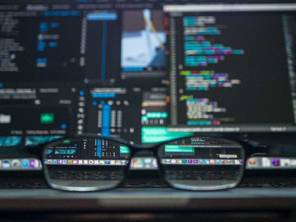 ai coding and blurred glasses