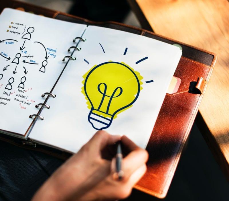 writing ideas light bulb in notebook