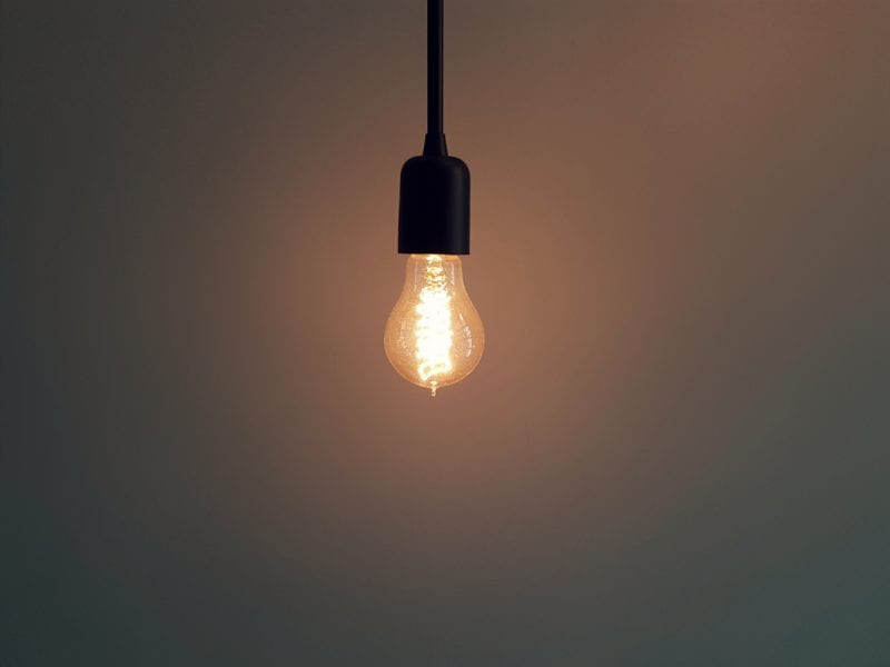bright light bulb in dark room