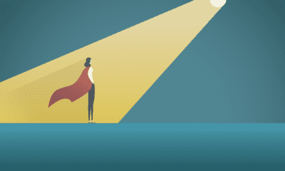 thought leader with cape standing in spotlight